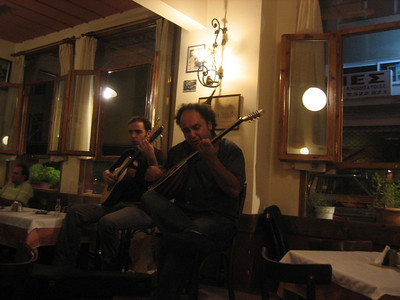 """A taverna in Thessaloniki called """"Toburlika"""" --recommended to us by a fellow in a music store. (We had a hard time finding it from his directions, but are glad we persisted. It's at corner of Olympiou str and Odoz Naimahile? Limnou.  About 50m north of Politehniou Str., west of Dodekanisou.) Musicians:  Pantelis Hatzikiriakos, bouzouki, and Dimitris Eseriadis, kithara (guitar)."""
