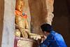 Applying gold leaf to a statue at Shwe Gu Gyi Phaya