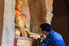 Applying gold leaf to a statue at Shwe Gu Gyi Phaya