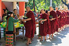 Monks receiving donation