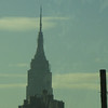 View of the Empire State Building from the race course in Queens