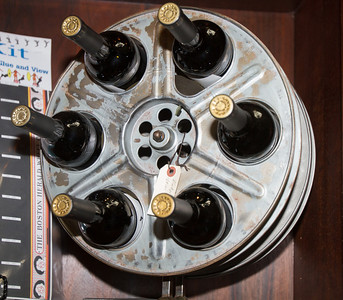 Very creative to turn old movie film reels into wine racks.