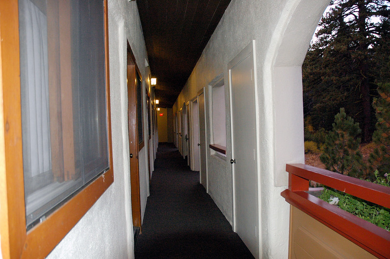 Outdoor hallway outside the room.