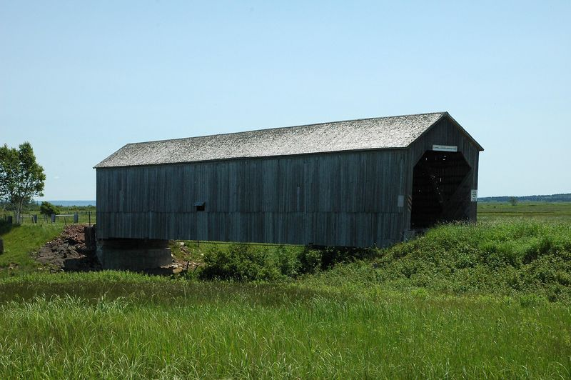 Covered bridge on the way to Hopewell Rocks.  Car had to stop on this shot...lost part of camera out the window.  OOPS