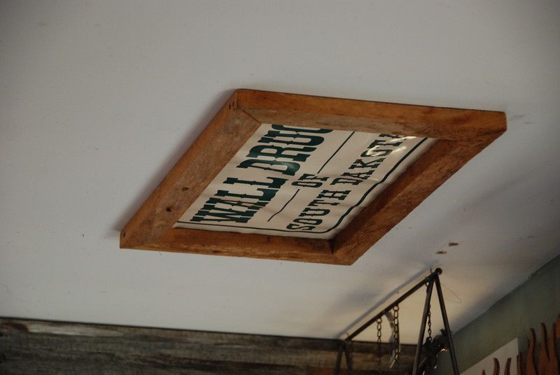 Wall Drug sign on the ceiling.
