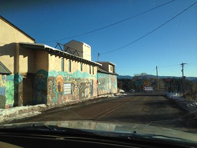 "Truchas, NM.  My sister helped create these murals years ago.  ""Make ART not Bombs."""