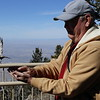 David Releasing Brown-capped Rosy-Finch @ Sandia Crest House
