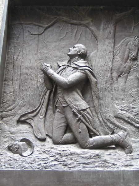 Plaque on Federal Hall depicting George Washington at Valley Forge