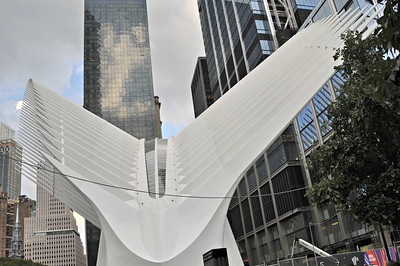 "Spanish architect Santiago Calatrava, designer of the station, said the Oculus resembles a bird being released from a child's hand. The roof was originally designed to mechanically open to increase light and ventilation to the enclosed space. Herbert Muschamp, architecture critic of The New York Times, compared the design to the Bethesda Terrace and Fountainin Central Park.  Cost and delays[edit] The Transportation Hub has been dubbed ""the world's most expensive transportation hub"" due to its massive cost for reconstruction—$3.74 billion dollars.[38][44] By contrast, the proposed two-mile PATH extension connecting Newark Liberty International Airport to the NWK-WTC service is projected to cost $1.5 billion.[45] The hub has also been criticized for being delayed almost 10 years.[46] Originally, the reconstruction was to be funded by the Federal Transit Administration, which gave approximately $1.9 billion to the project. The costs of the hub were still expensive, but it was to be finished at budget in 2009. In 2014 dollars, the cost of the hub and the adjacent Fulton Center, combined, was $5.1 billion.[47] The hub cost twice as much in 2014 as it should have originally cost in 2004.[46] A single hallway in the elegantly constructed hub cost $225 million and was billed as the ""world's most expensive hallway"",[48] while construction, maintenance, and management alone cost $635 million; the Port Authority awarded several subcontracts, most of them costly.[46] In addition, over $500 million in cost savings was overlooked.[46] The price of the station was further driven up by Calatrava's architectural decisions.[a 1] He wanted to import custom-made steel from a northern Italian factory, which cost $474 million, and have a columnless, aesthetically based design; skylights in the ground, instead of trees;[a 2] and large, soaring ""wings"", or rafters.[46] Another $335 million was added to the cost overrun because the Port Authority of New York and New Jersey had to build around the New York City Subway's IRT Broadway – Seventh Avenue Line (carrying the 1 train), since the Metropolitan Transportation Authorityrefused to close the line due to fears of inconveniencing commuters from Staten Island taking the Staten Island Ferry. The line had to be supported on a bridge over the station instead of on columns through the station.[46] In 2012, Hurricane Sandy damaged several hundred million dollars worth of materials.[46] The hub's skyrocketing costs also attracted much controversy, with an editor at The New York Times saying that ""Mr. Calatrava is amassing an unusually long list of projects marred by cost overruns, delays and litigation"", referring to his other projects around the world that were over budget.[49] Especially because the current station has a ridership of only 46,000 daily passengers compared to 250,000 at Grand Central Terminal) some think that the renovation is overpriced and overstylized.[46] On November 5, 2015, the opening was delayed to early 2016, due to a leaking roof.[50] The director of the Port Authority, Pat Foye, declined to hold an event to celebrate the opening of the Hub, describing it as ""symbol of excess"" and noting he was ""troubled with the huge cost"" of the construction project.[51]"
