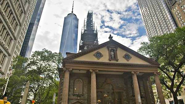 """September 11, 2001[edit] The rear of St. Paul's Chapel faces Church Street, opposite the east side of the World Trade Center site. After the attack on September 11, 2001, which led to the collapse of the twin towers of the World Trade Center, St. Paul's Chapel served as a place of rest and refuge for recovery workers at the WTC site.  For eight months, hundreds of volunteers worked 12-hour shifts around the clock, serving meals, making beds, counseling and praying with fire fighters, construction workers, police and others. Massage therapists, chiropractors, podiatrists and musicians also tended to their needs.  The church survived without even a broken window. Church history declares it was spared by a miracle sycamore on the northwest corner of the property that was hit by debris. The tree's root has been preserved in a bronze memorial by sculptor Steve Tobin. While the church's organ was badly damaged by smoke and dirt, the organ has been refurbished and is in use again.[8]  The fence around the church grounds became the main spot for visitors to place impromptu memorials to the event. After it became filled with flowers, photos, teddy bears, and other paraphernalia, chapel officials decided to erect a number of panels on which visitors could add to the memorial. Estimating that only 15 would be needed in total, they eventually required 400.  Rudolph Giuliani gave his mayoral farewell speech at the church on December 27, 2001.  The Chapel is now a popular tourist destination since it still keeps many of the memorial banners around the sanctuary and has an extensive audio video history of the event. There are a number of exhibits in the Chapel. The first one when entering is """"Healing Hearts and Minds"""", which consists of a policeman's uniform covered with police and firefighter patches sent from all over the country, including Iowa, West Virginia, California, etc. The most visible is the """"Thread Project"""", which consists of several banners, each of a different color"""