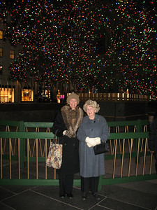 Mama and me in front of the tree.