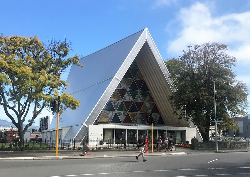 "The Christchurch Cathedral was heavily damaged in the earthquakes and is currently unusable.  This small building is the temporary Cathedral for the archdiocese of Christchurch.  It is referred to as ""The Cardboard Cathedral"" as much of the temporary interior décor is made of cardboard."