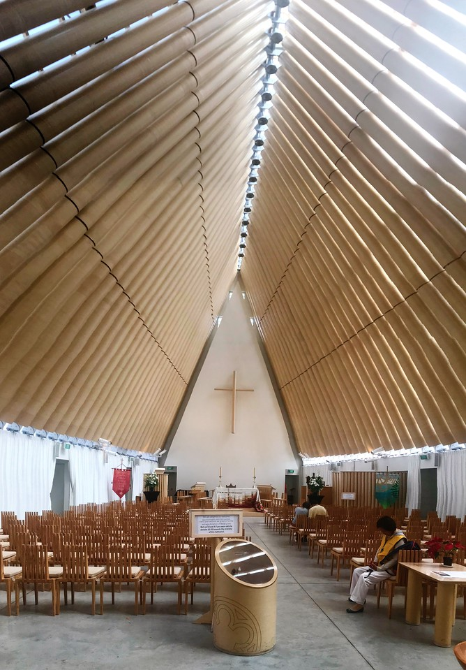 """The interior of the temporary cathedral showing the """"cardboard"""" columns of the rood from which the nickname """"cardboard cathedral"""" comes from."""