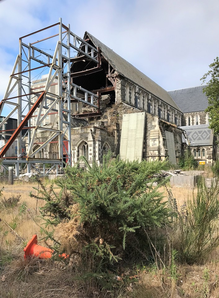 The front of Christchurch Cathedral where the tall spire once stood.  The bracing keeps more of the building from collapsing.