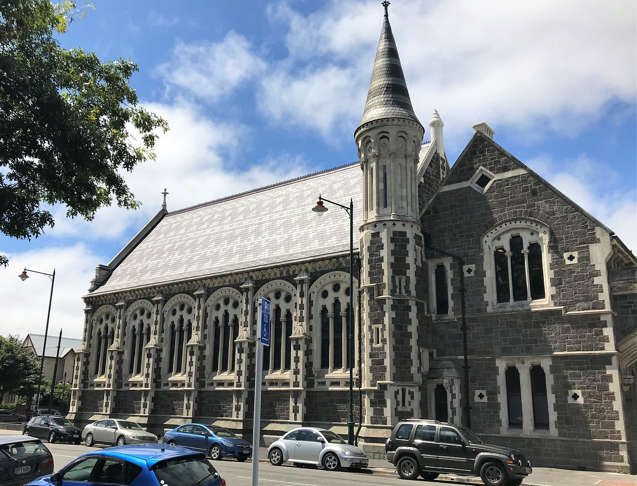 Buildings of the Arts Center of Christchurch.  It is a collection of Gothic Revival buildings that date from 1877 and were formerly used by Canterbury College (now the University of Canterbury) and two of the city's secondary schools.  They were heavily damaged in the earthquake and are undergoing a $300M restoration.