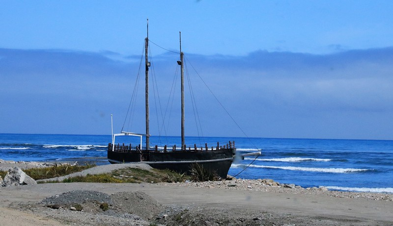The Tasman Sea and an old boat that ran aground long ago.