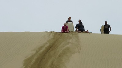 "Sand boarding...awesome...we climbed up a 150ft sand dune and away we went! Not bad for ""old"" folks!"