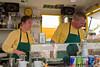 The crepe makers are hard at work. Honey, where did you put the Nutella?<br /> -----<br /> Le couple s'affaire autour de nos crêpes. Chéri, où as tu planqué le nutella??