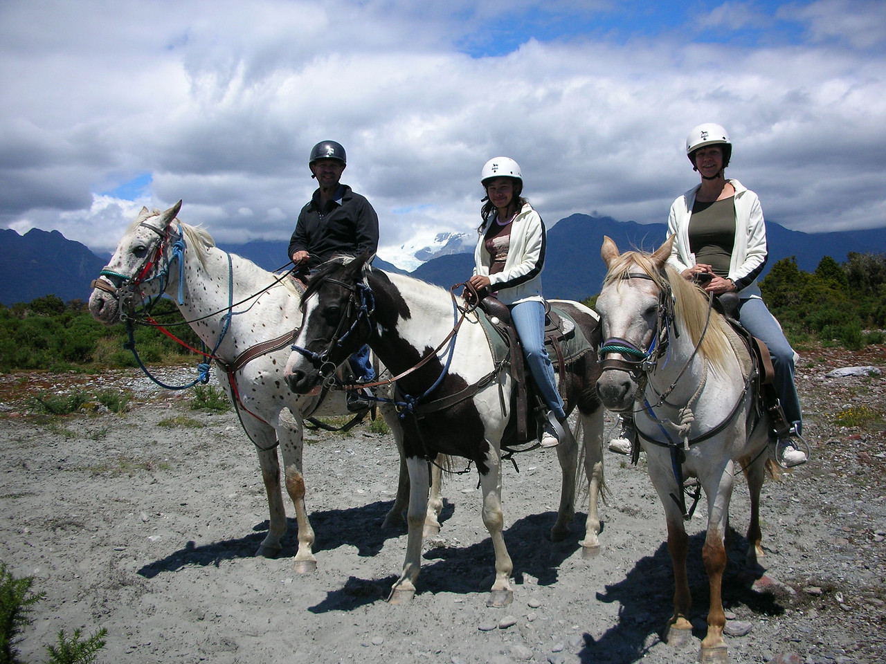 Hans, Ila and Naomi horse trekking at Frans Josef Glacier.