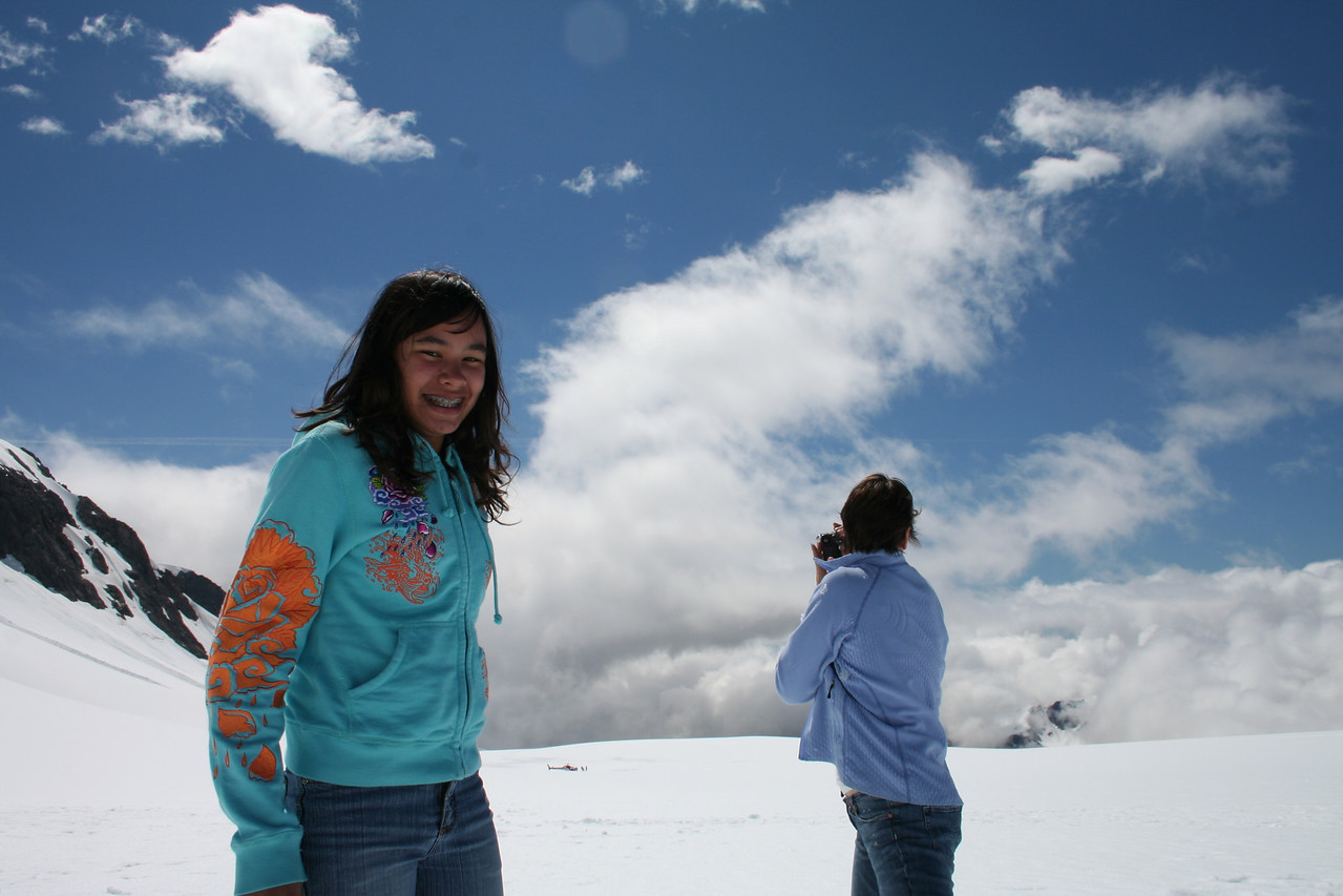 Naomi and Ila filming the Fox Glacier from above the clouds.