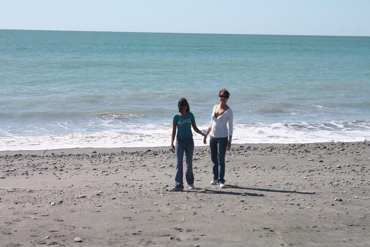 Ila and Naomi on the Beach below Fox Glacier. This is the Tasman Sea.