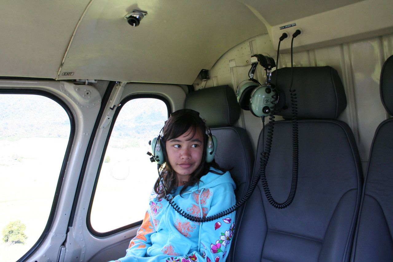 Naomi on the helicopter ride up to the top of the Fox Glacier.