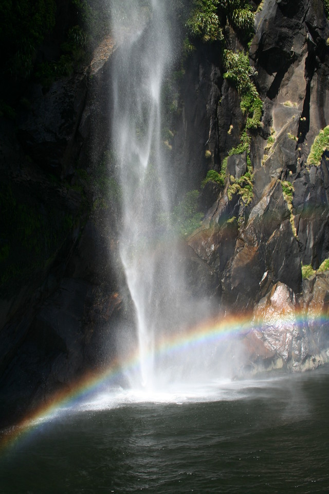 Waterfall and raindbow in Milford Sound.