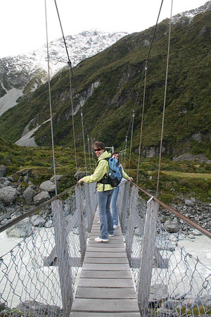 A swing bridge across a glacial stream in the Hooker Valley. (Note: Ila is afraid of heights!)