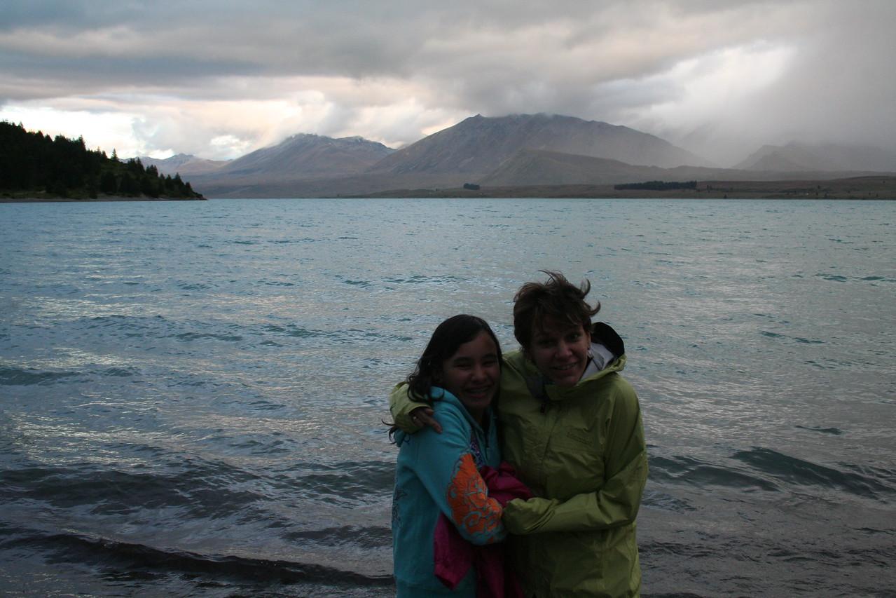 Ila and Naomi wondering who turned down the AC at Lake Tekapo.