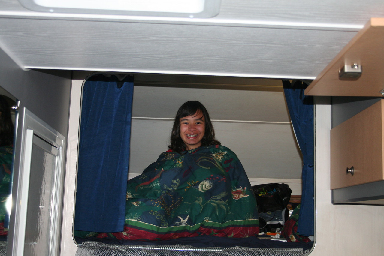 """Naomi in the """"cave"""" of the campervan."""