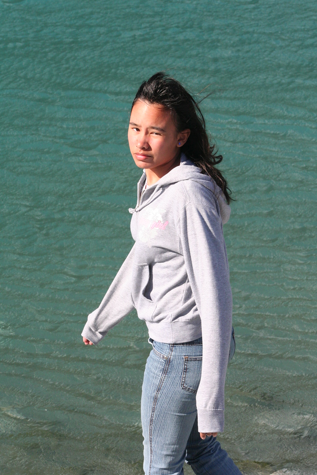 Naomi at a river in New Zealand along the Haast Highway.