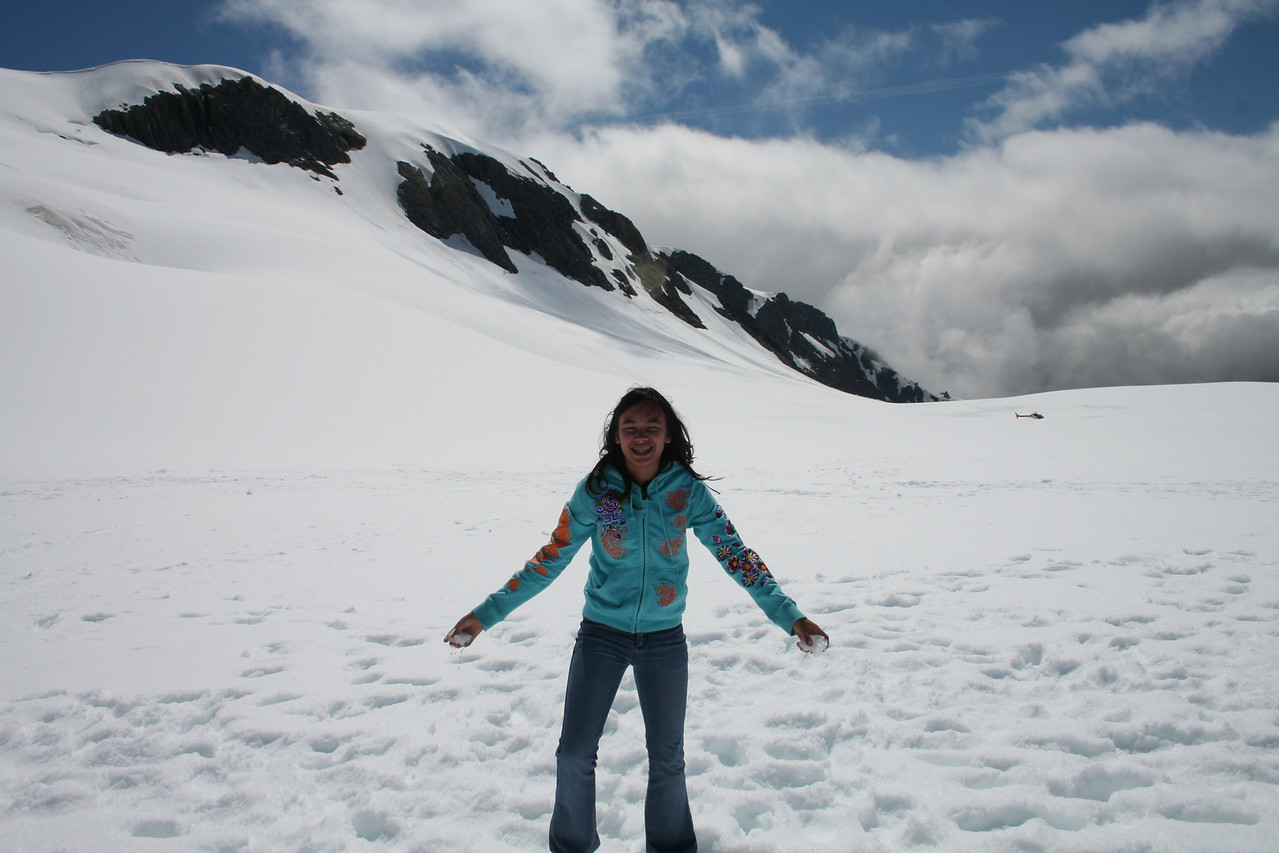 Naomi enjoying the snow on the Fox Glacier. We are now above the clouds and it is beautiful bright sunshine.