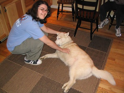 Robin, a good college friend, with my grandfather's dog Tia, the slower of two 3-legged huskies (the other is missing a back leg and isn't particularly slow).