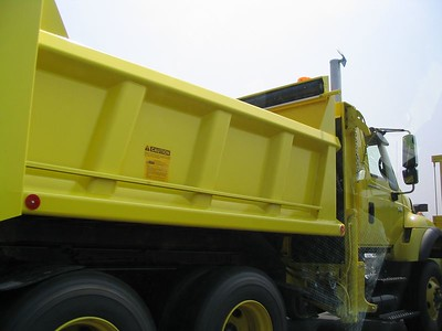 Large, new, bright yellow truck!