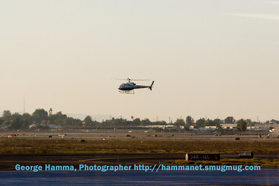 All the time we were at the Long Beach airport, we saw helicopters hovering at a pad in the center of the airport.  Every so often one would take off and do a loop around the airport, returning to the pad.  It seemed obvious there must be a helicopter flying school.