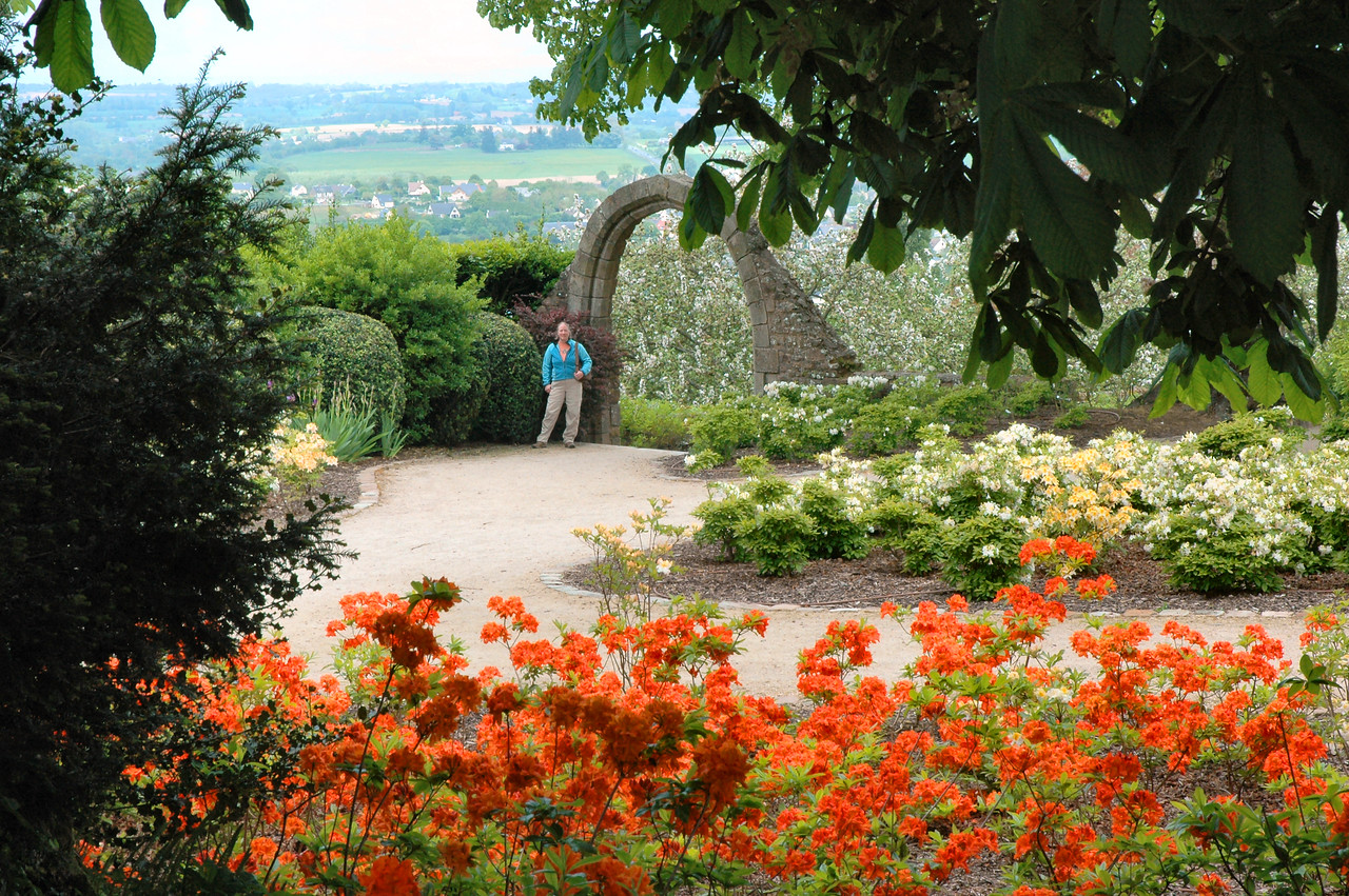 Avranches - Le Jardin-des-Plantes - Judy by the arch.  The Jardin received a major overhaul in 2007.  I don't find it quite as charming as I did, but this spot is still beautiful.