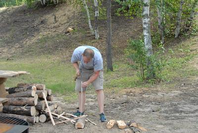 Allen chopping up a really big log.