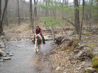 Judy crossing the creek.