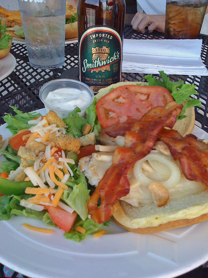 "This was my chicken sandwich w/provolone ,bacon, tomatoe, lettuce, etc. w/side salad and ""smiddicks"" from International Cafe in NMB."