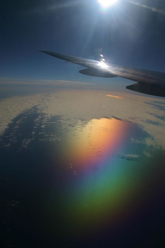 The combination of the airplane window and my circular polarizing filter made the ocean look very cool.
