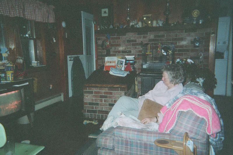 Mom In kitchen watching TV