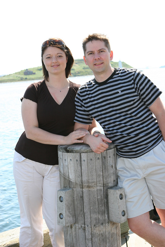 Chris and Shanin posing at the same spot, downtown Halifax on the boardwalk.