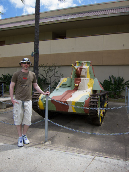 Me in front of a tiny Japanese tank at Fort Derussy
