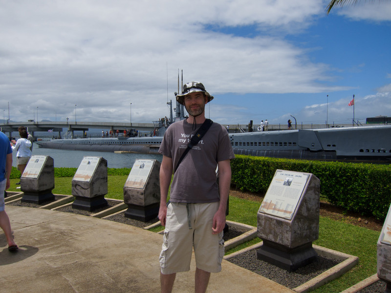 Me on the shore of the Pearl Harbor Visitor Center.  Memorials for lost ships and crewmen and the USS Bowfin behind me.