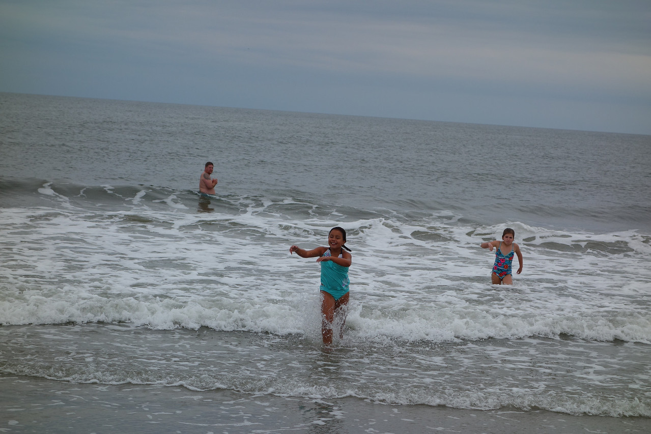 Monday, Matt shows up in the water to play with the girls