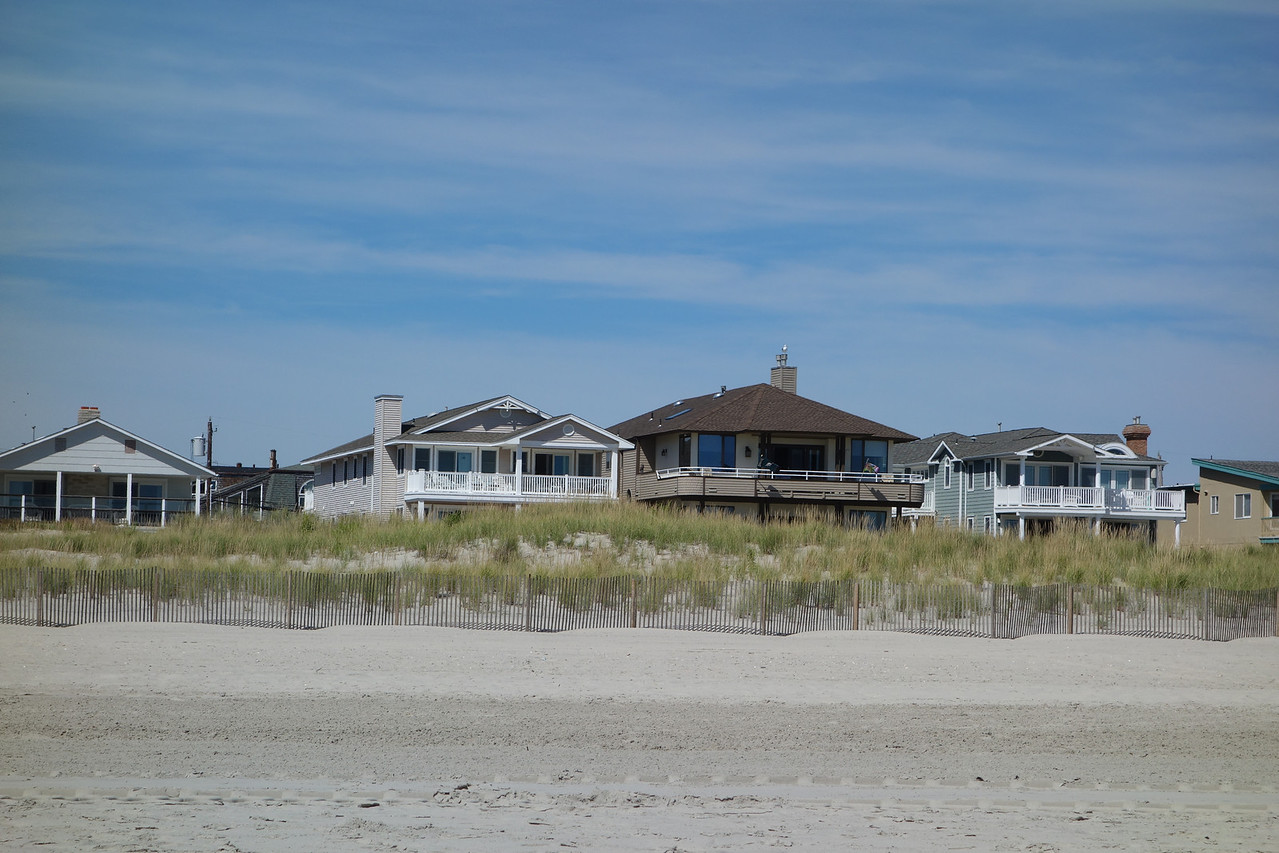 Our house from the beach (tan with white rails next to brown one)