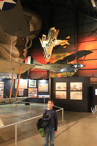 March 21, 2013 - (Wright-Patterson Air Force Base [National Museum of the United States Air Force] / Dayton, Montgomery County, Ohio) -- Aaron below World War I (1917) German Fokker Triplane