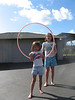 Jumping with hula hoops.