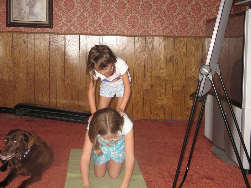 Alena and Elise tumbling with Moxie helping.