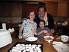 Alena, Elise, and Ed preparing dinner